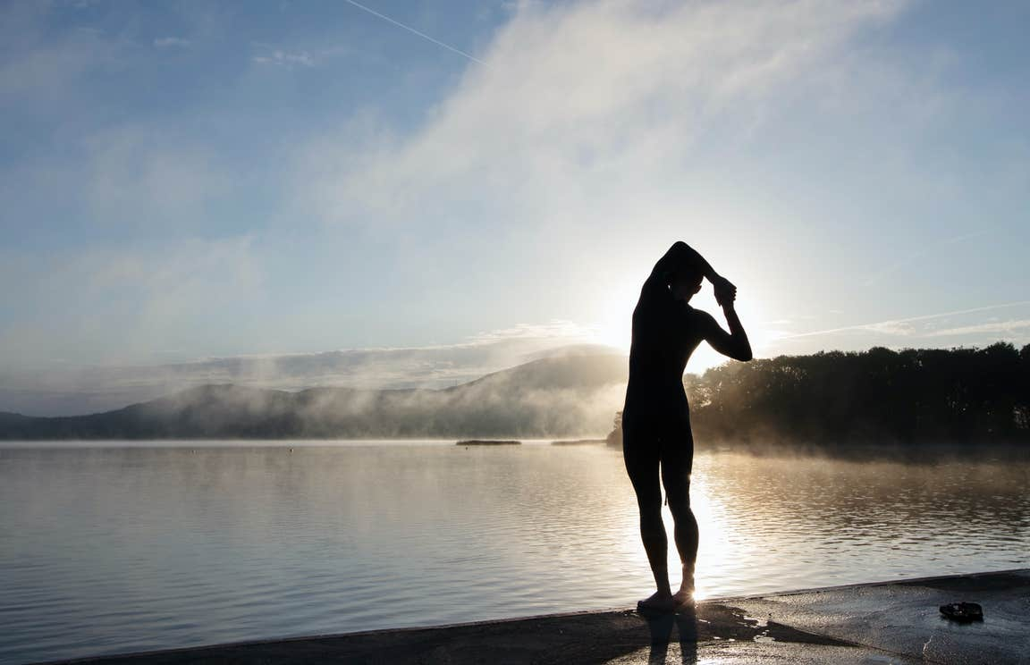 Swimmer stretching at Lough Derg in Killaloe, County Clare