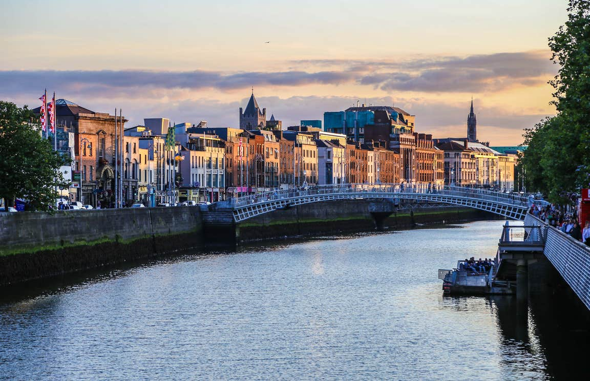 A view of Dublin's Ha'penny Bridge with buildings in the background