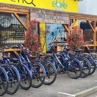 A row of bicycles outside carlingford greenway bicycle hire shopfront