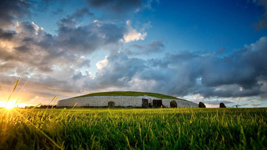 Sunrise at Newgrange in a grassy field