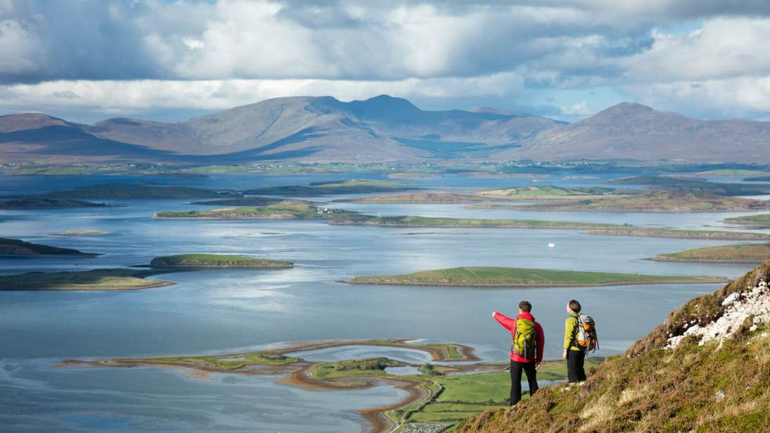 Two people overlooking Clew Bay from Croagh Patrick in Mayo