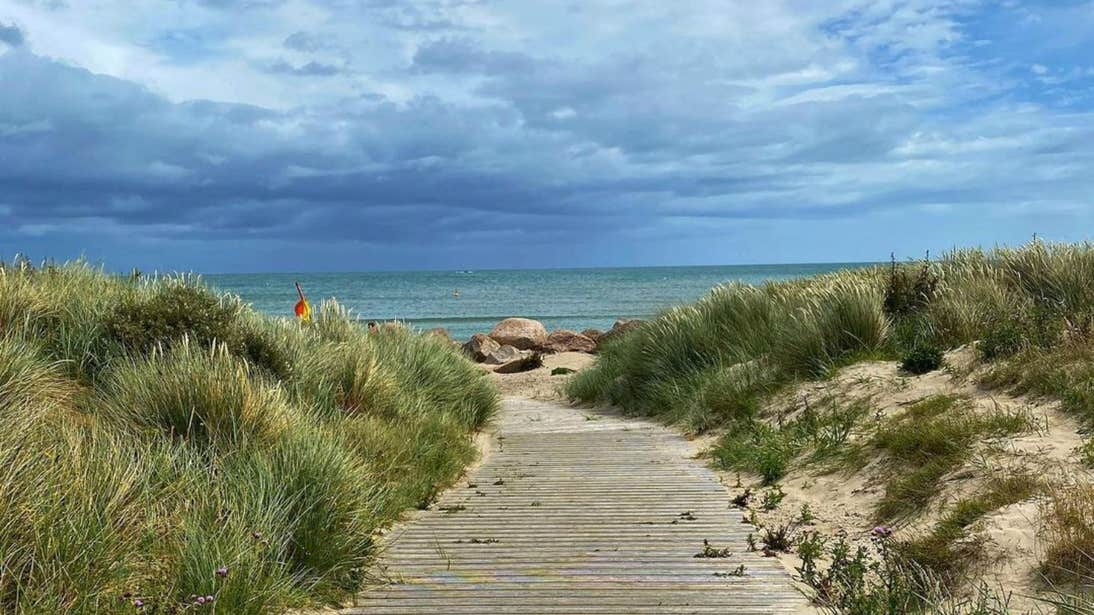 A wooden pathway leading to the shore at Carne Beach, Wexford