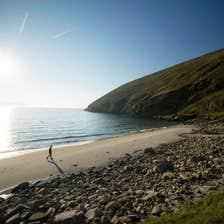 Image of walker on Keem Beach, Achill Island, County Mayo