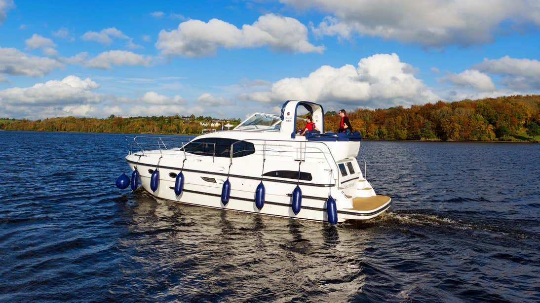 White boat with blue floats on the River Shannon