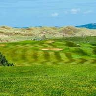 Bundoran Golf Club fairway with sand dunes in background