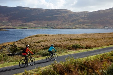 Two people cycling along the Great Western Greenway, Mayo