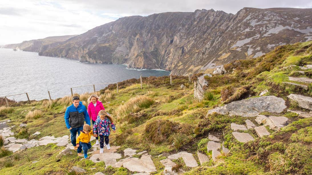 A young family hiking at Sliabh Liag Cliffs (Slieve League), Donegal
