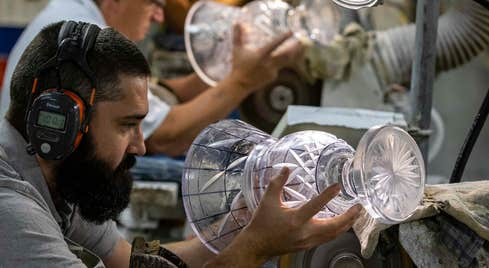 Craftsman working on a piece of Waterford crystal