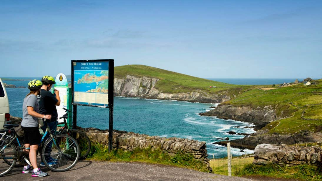 Cyclists on the road overlooking Slea Head , Co. Kerry