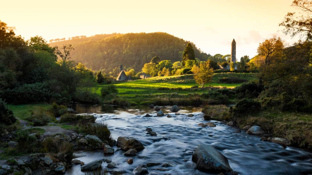 Sunset views of the mountains and round tower at Glendalough