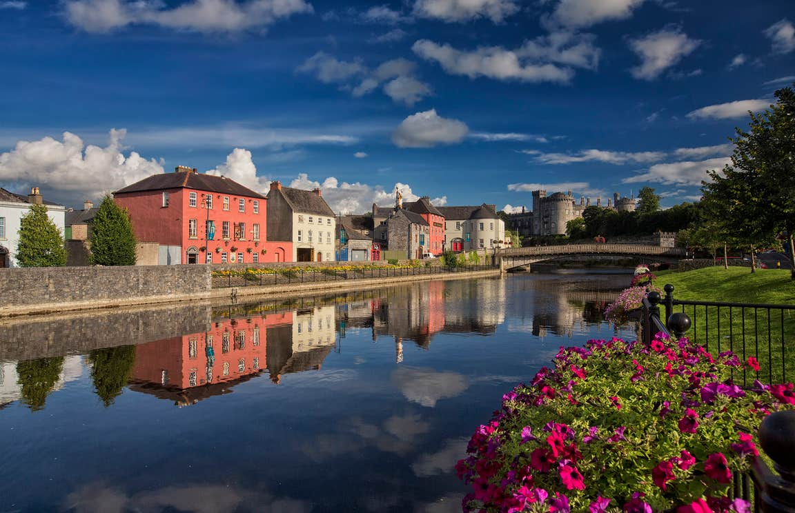 Reflections of colourful buildings on a river in Kilkenny City, Kilkenny