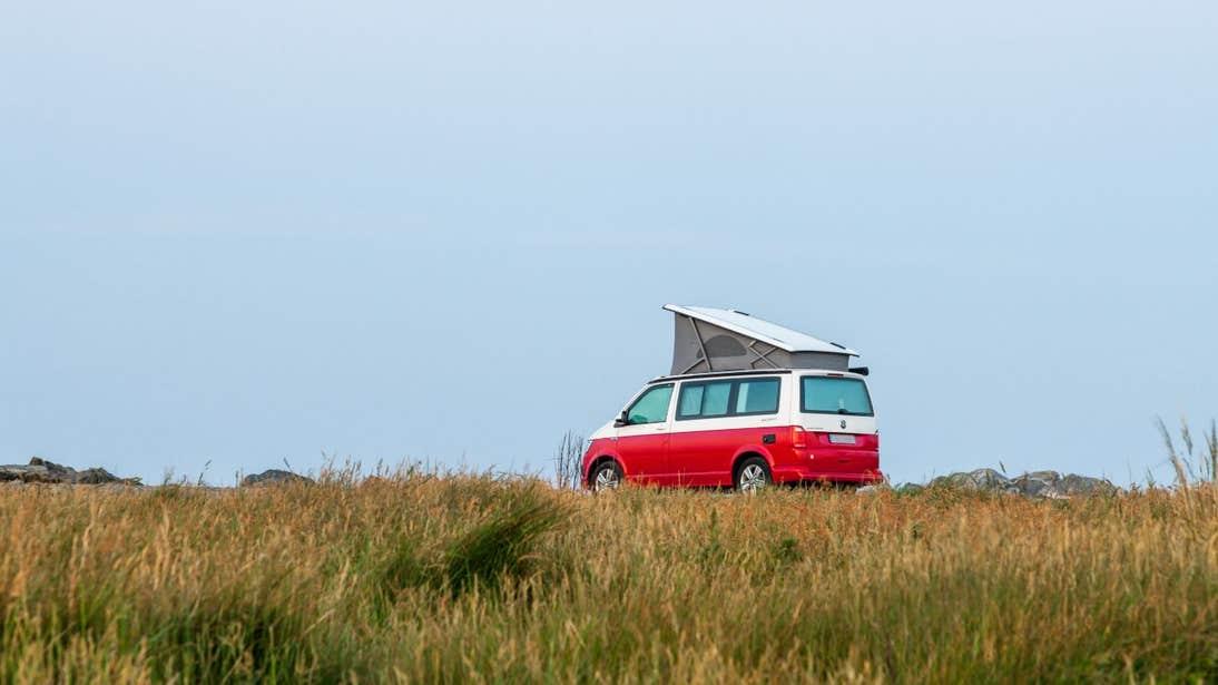 Red campervan on Garretstown Beach, Co Cork
