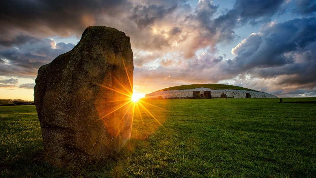 Sunset behind Newgrange in County Meath
