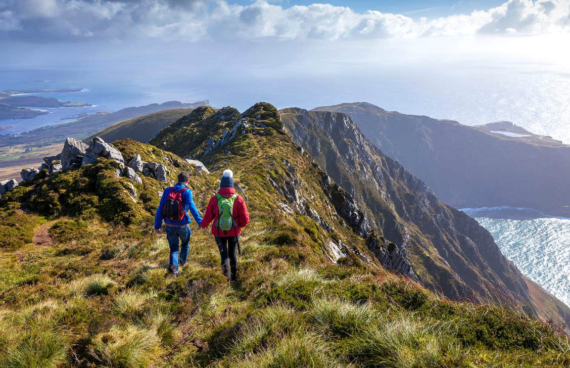 Two people hiking on the Slieve League Cliffs, Donegal