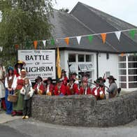 People in historical costume outside the Battle of Aughrim Visitor Centre