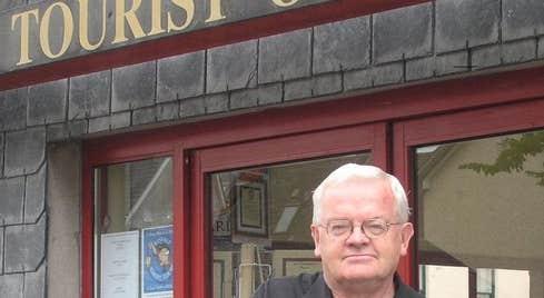 Kinsale Heritage Town Walk guide Dermot Ryan in front of the tourist office