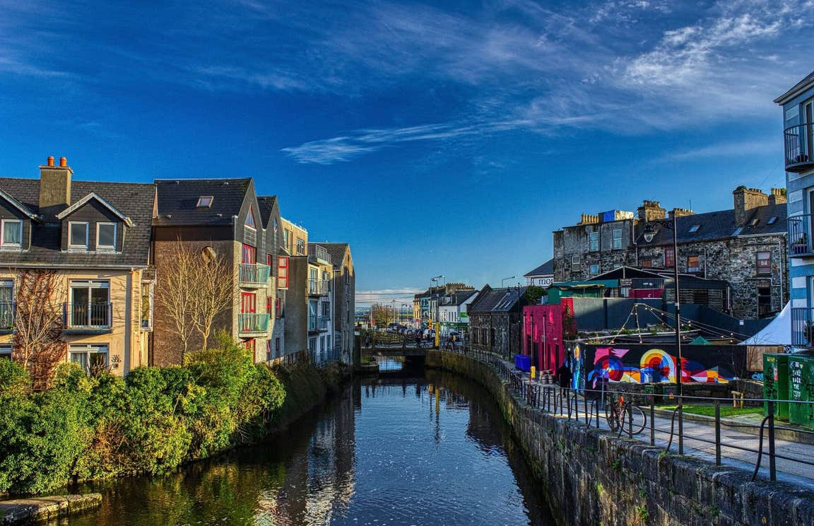 A view of apartments and street art along the still waters of Eglington Canal in Galway.