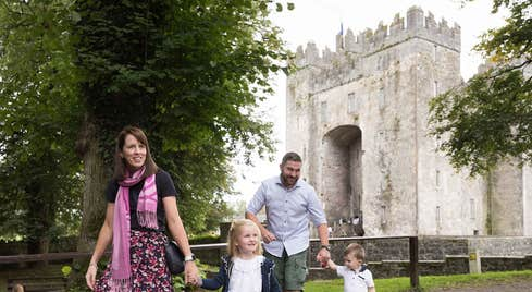 A family walking within the grounds of Bunratty Castle and Folk Park