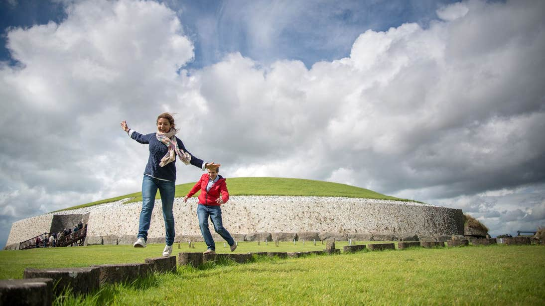 People playing outside Newgrange in County Meath