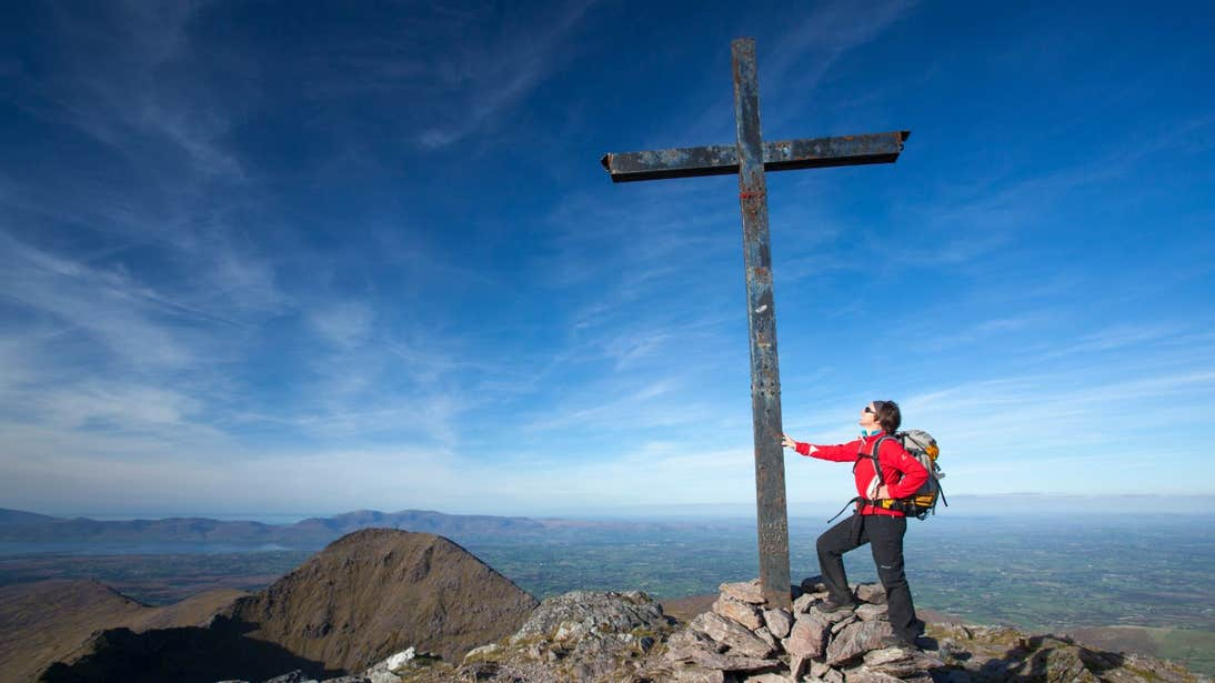 Person standing at the summit of Carrauntoohil, Co Kerry
