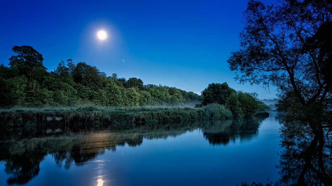 Full moon shining brightly over the River Boyne at night time