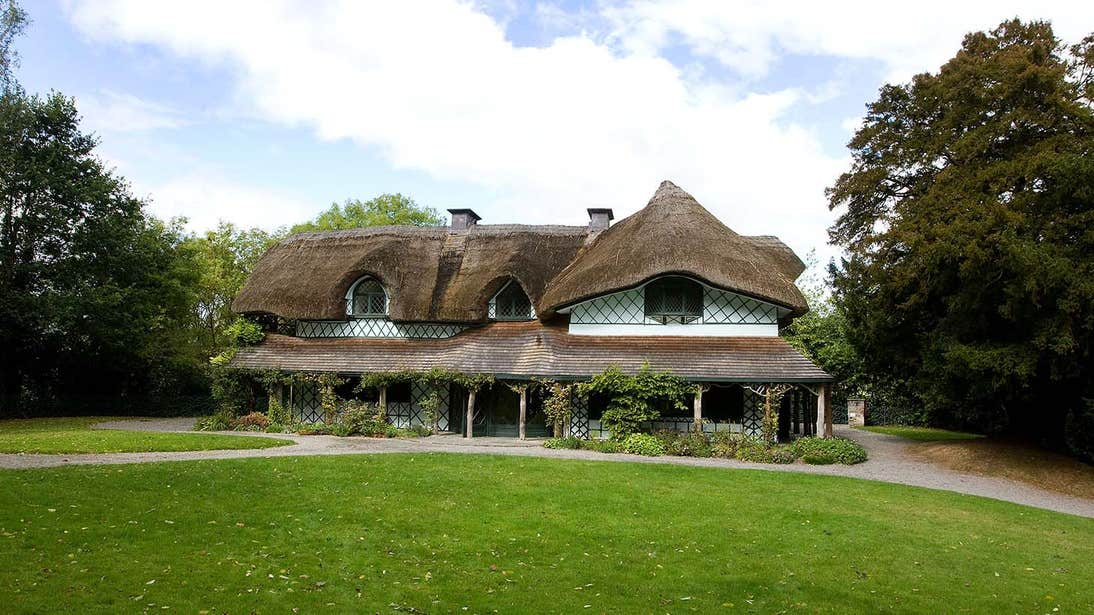 A thatched roof building with trees nearby in Cahir, Tipperary