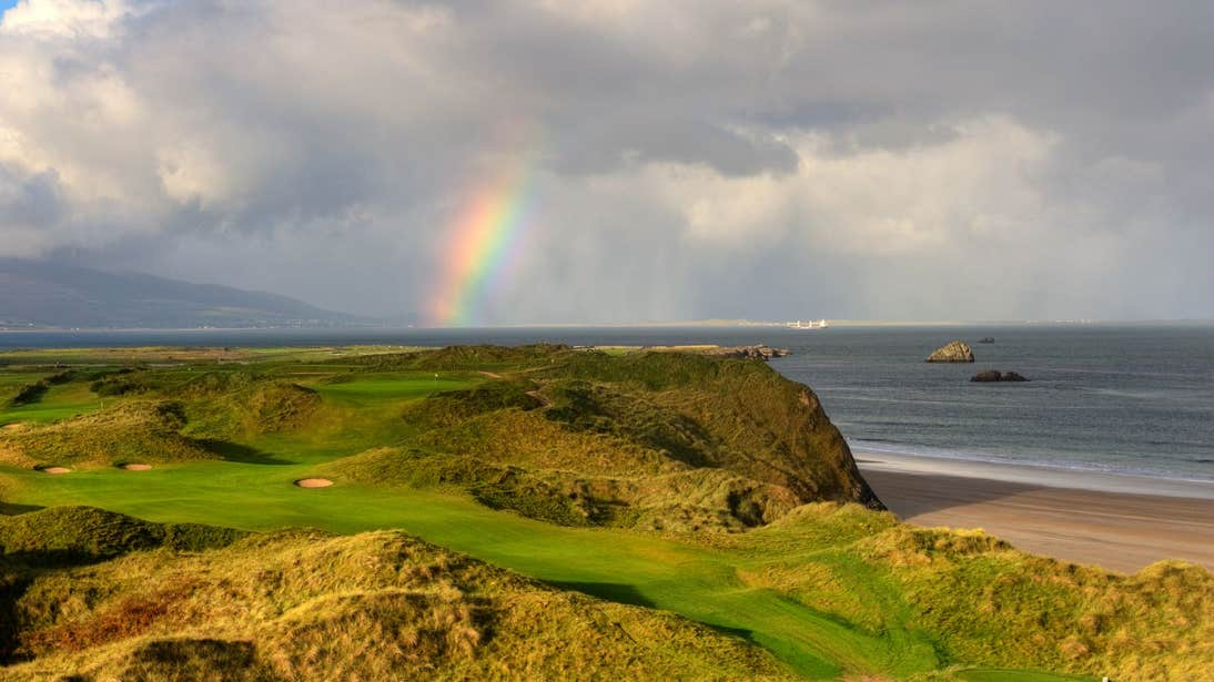 Rainbow over Tralee Golf Course beside the sea in County Kerry