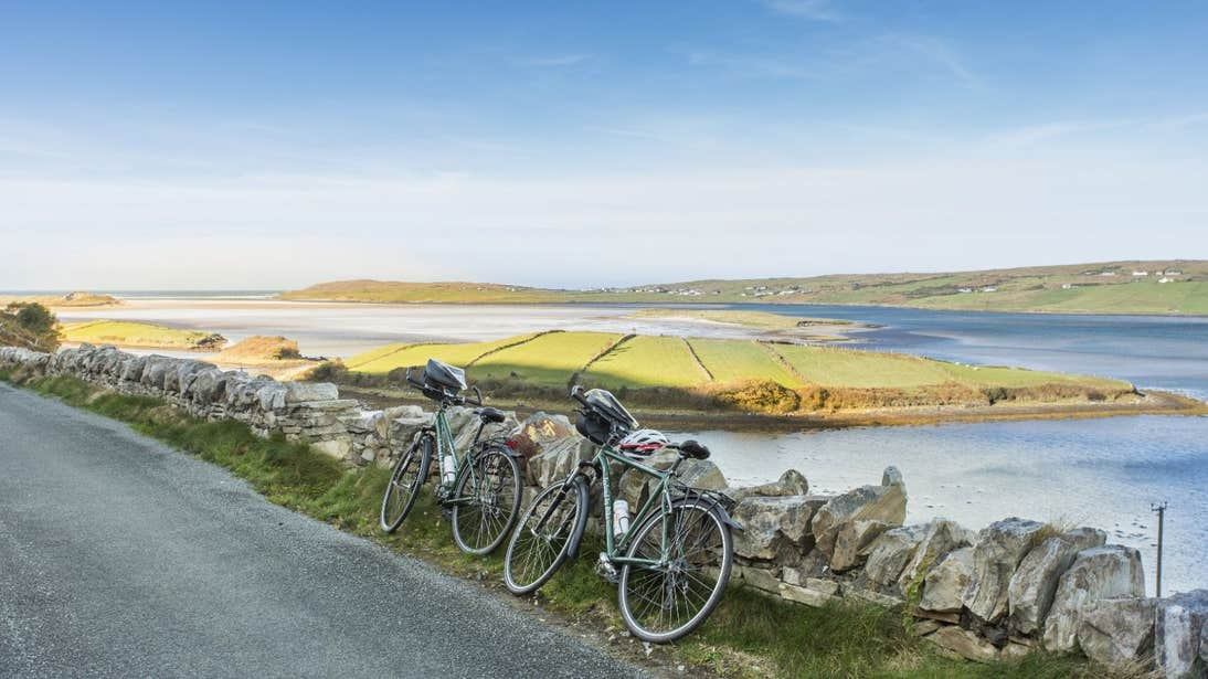 Two bikes on a road beside Maghera Beach in Co. Donegal