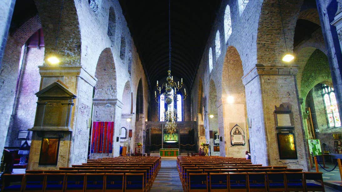 Row a pews in front of an alter inside Saint Mary's Cathedral, Limerick