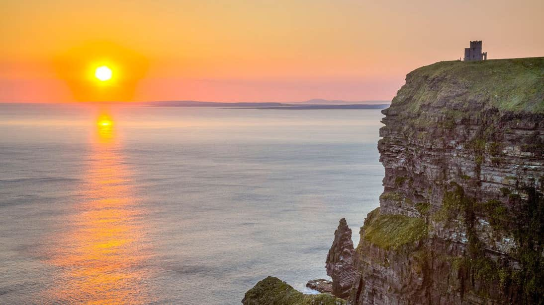 The sun setting over the Cliffs of Moher Coastal Walk, County Clare