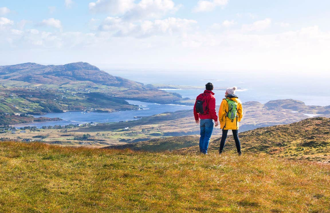 A couple out on a walk at Sliabh League (Slieve League) in Donegal, along the Wild Atlantic Way.