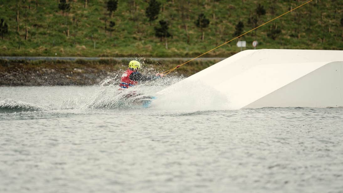 Person wearing a helmet while wakeboarding at Ballyhass Adventure Group in Cork