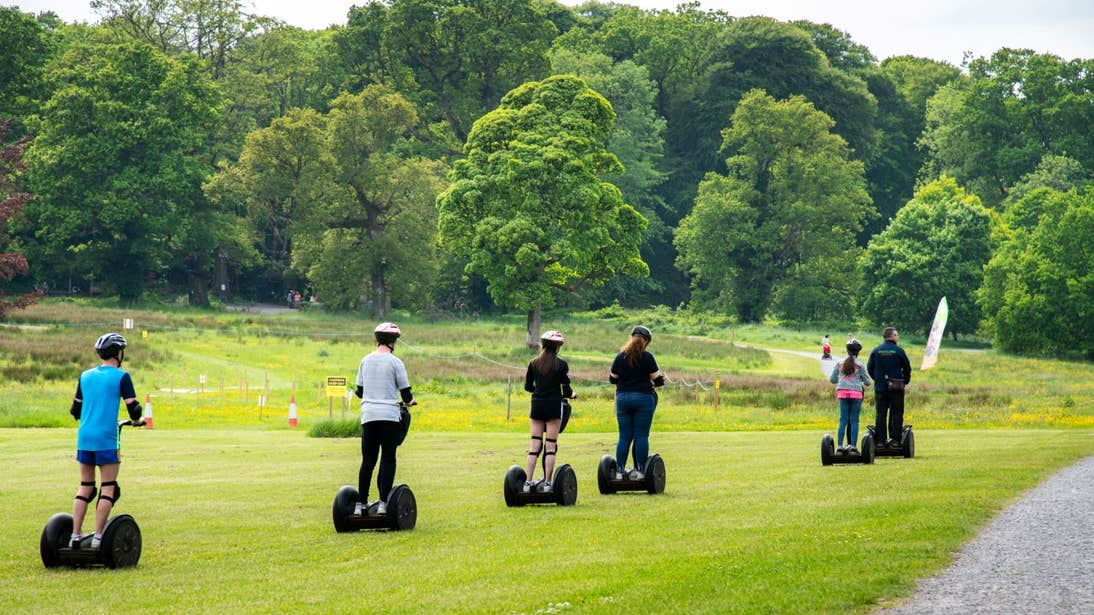 Six people riding a Segway on grass in Lough Key, Roscommon