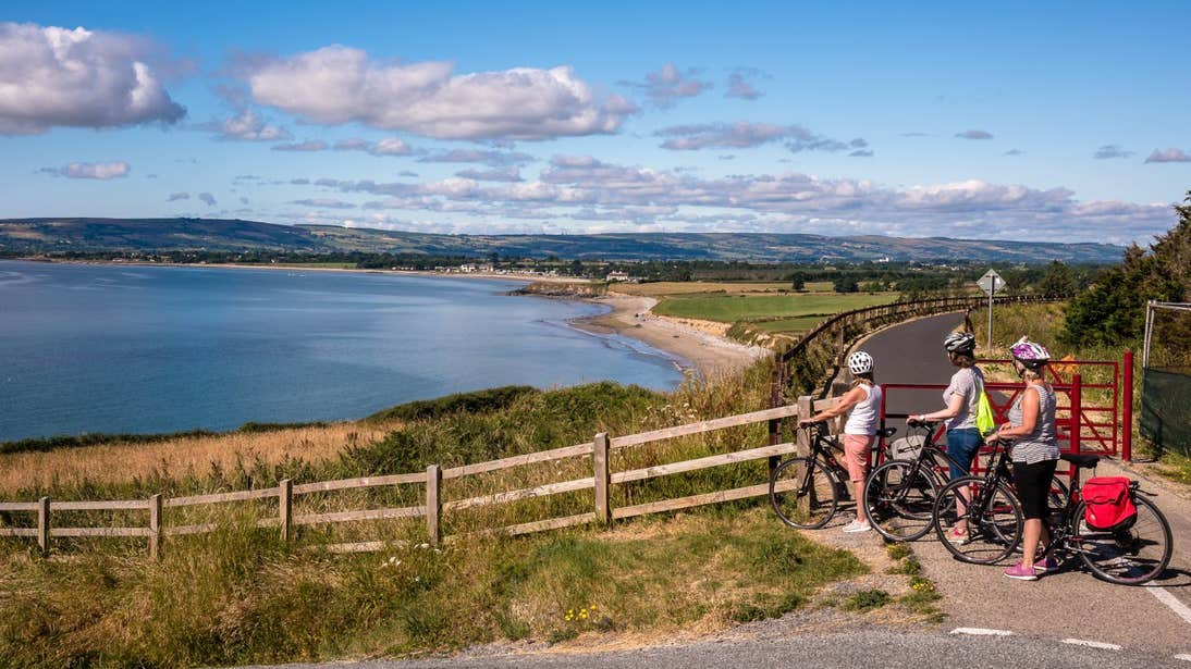 A young family cycling on the Waterford Greenway, County Waterford