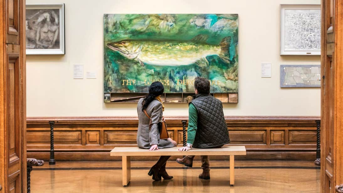 Two people looking at a painting in Crawford Art Gallery, Cork