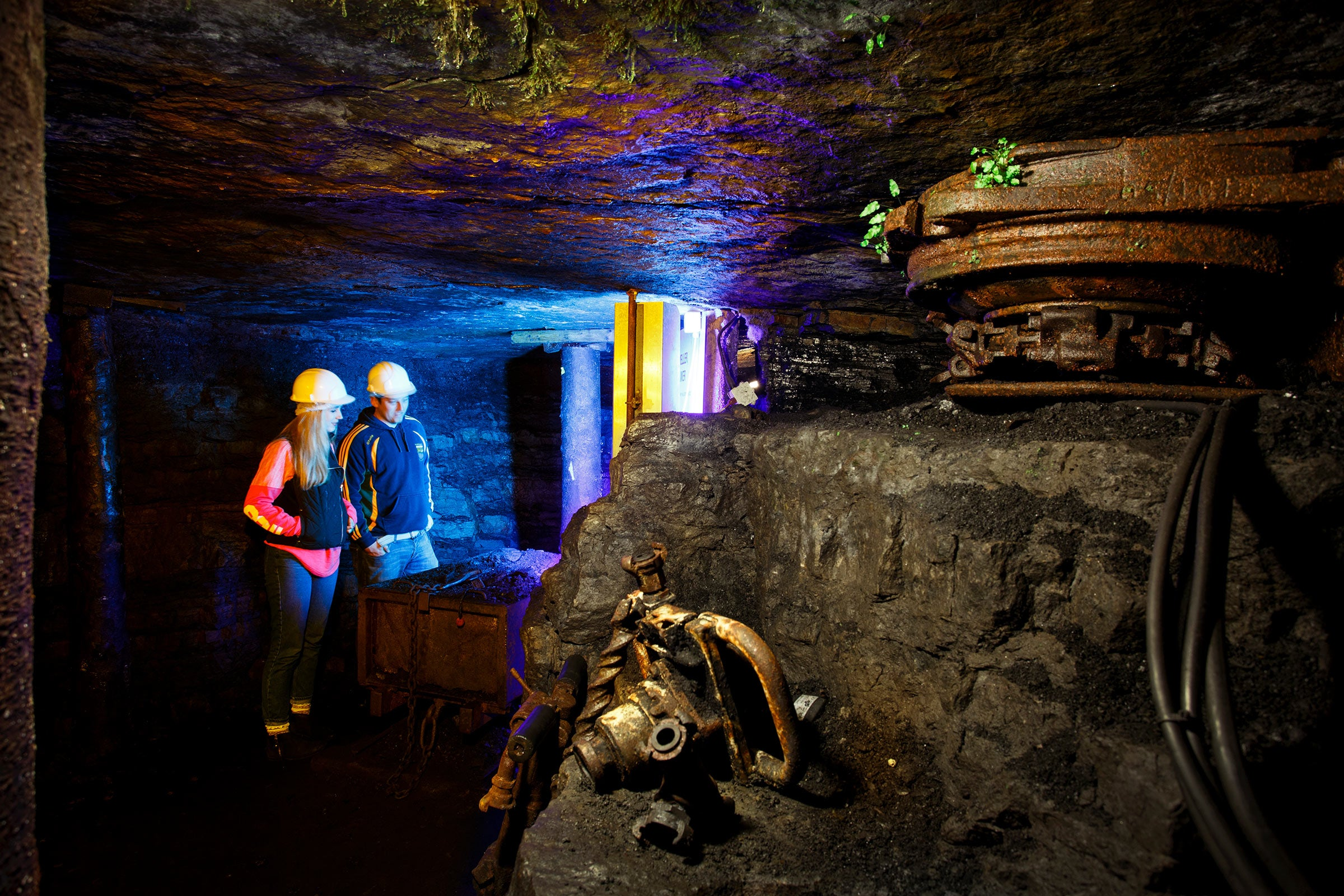 Two people on a tour of Arigna mining experience in County Roscommon.