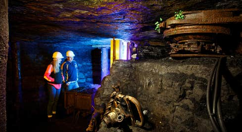 Two people wearing hard hats on a tour of Arigna Mining Experience in County Roscommon.