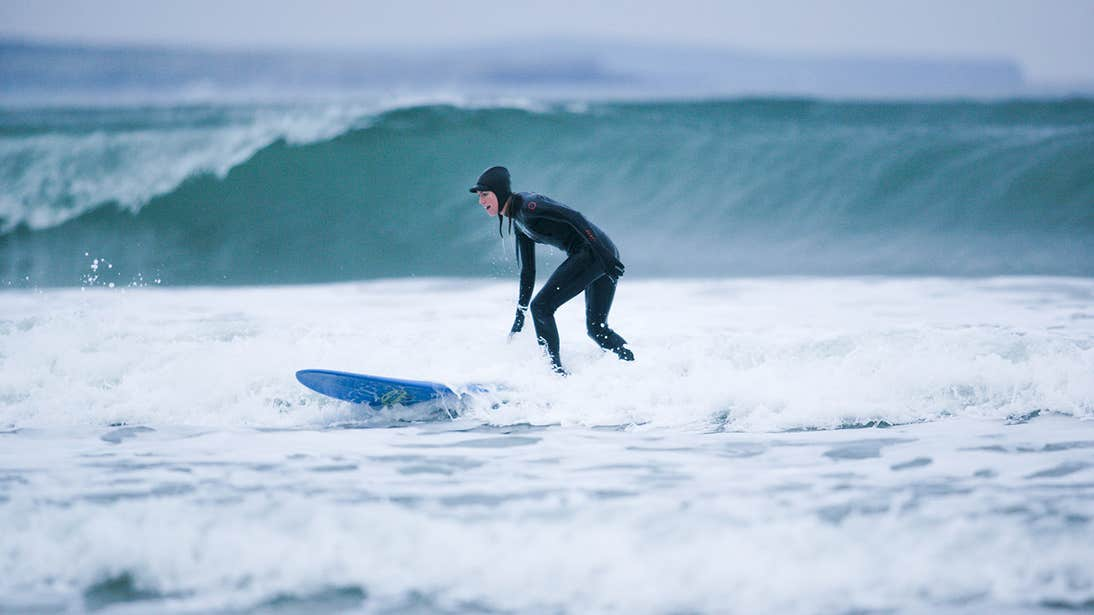 A surfer at Strandhill in County Sligo wearing a wetuit
