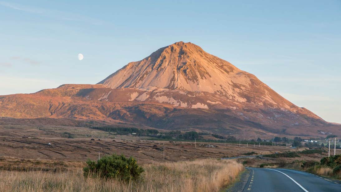 Errigal in County Donegal at dusk under a full moon