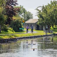Two cyclists cycling along the Royal Canal Greenway