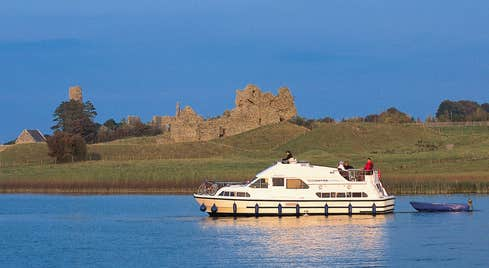 A group of people on a boat cruising the River Shannon near Clonmacnoise, Co.Offaly