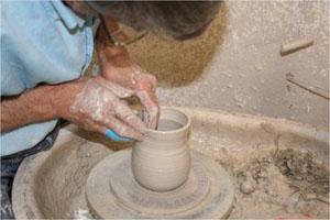 Alan Gaillard Potter throwing a mug