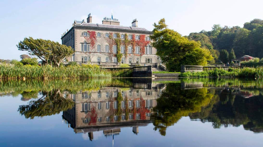 Image of Westport House reflected in a lake in Westport, Co Mayo
