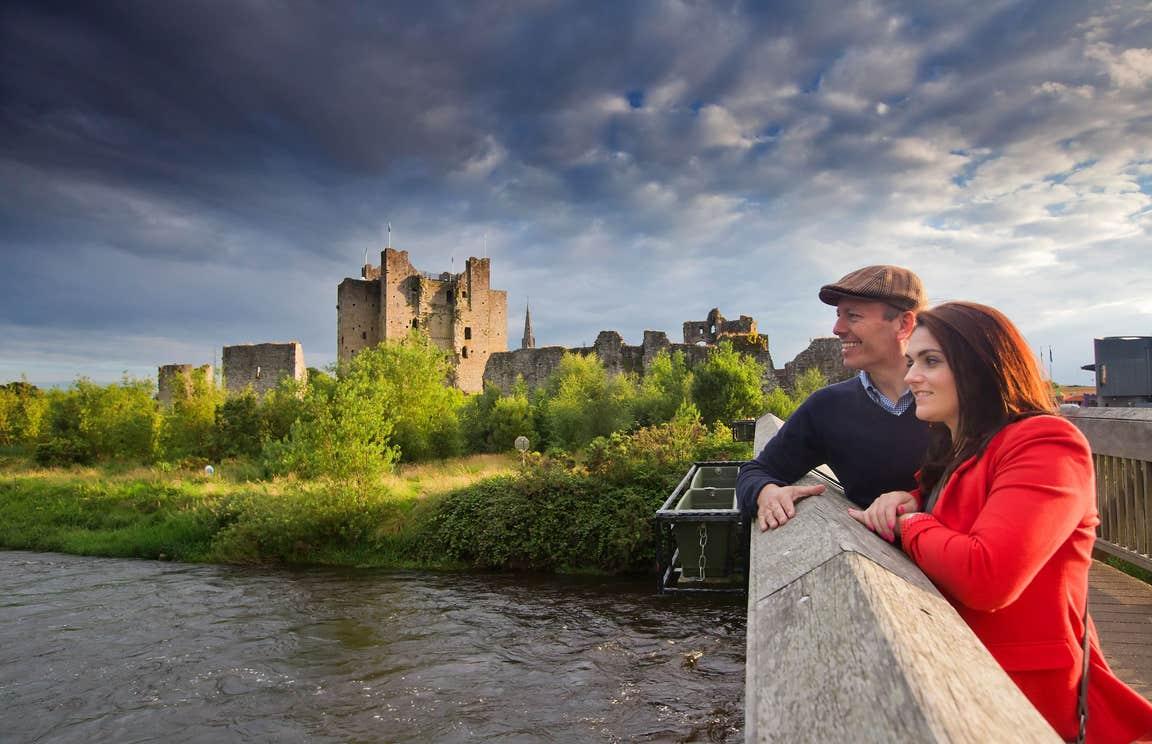 A couple on a bridge by the River Boyne at Trim Castle, Meath