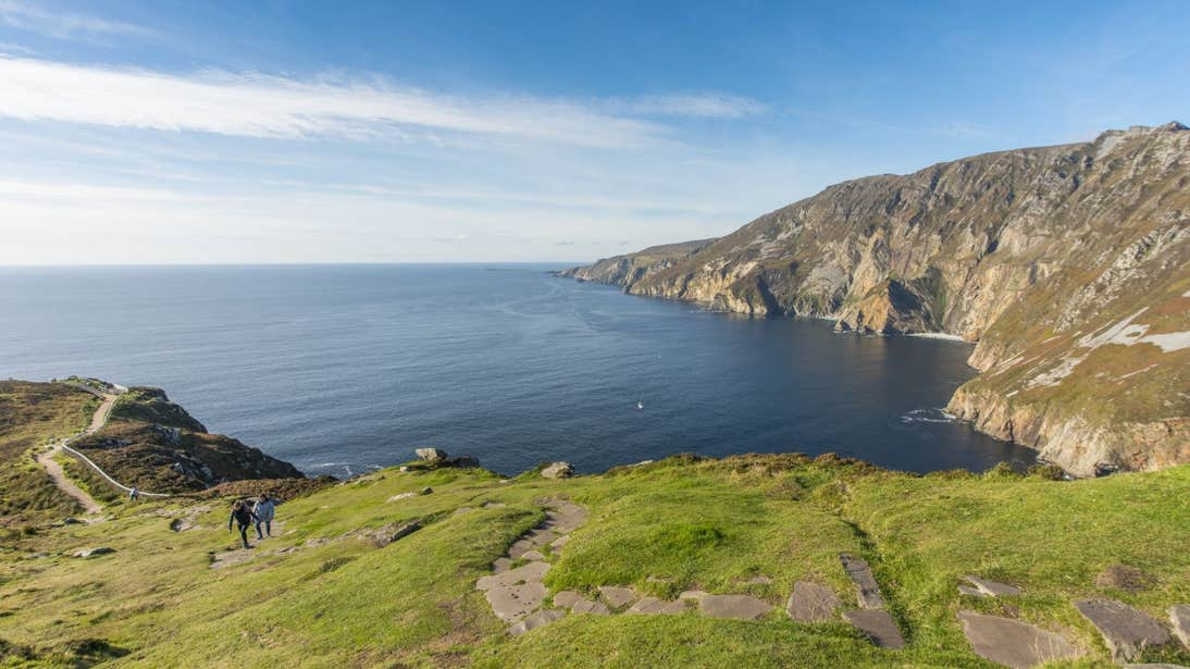 Two people walking on a trail at Sliabh League Cliffs in Co. Donegal
