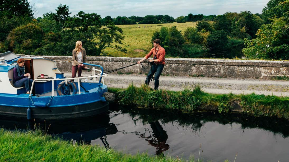People on board a barge getting ready to set sail in Sallins, Kildare