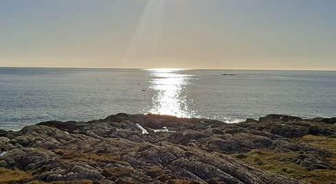 Ionad Na Feamainne Seaweed Centre coastline at sunset
