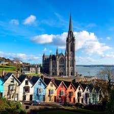 Colourful buildings in front of a cathedral in Cobh, Cork