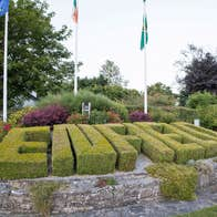 The word Enfield spelled out as a hedge in shrubbery as you enter town