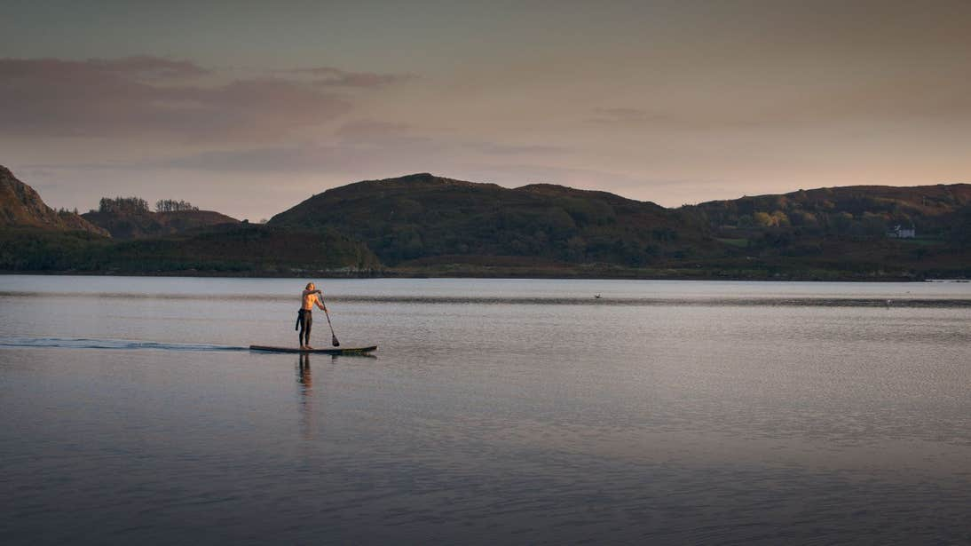 A person Sup on Lough Hyne at sunset